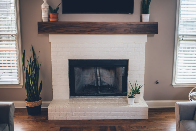 Modern white brick fireplace walnut mantel diy the southern trunk - Black and white fireplace ...